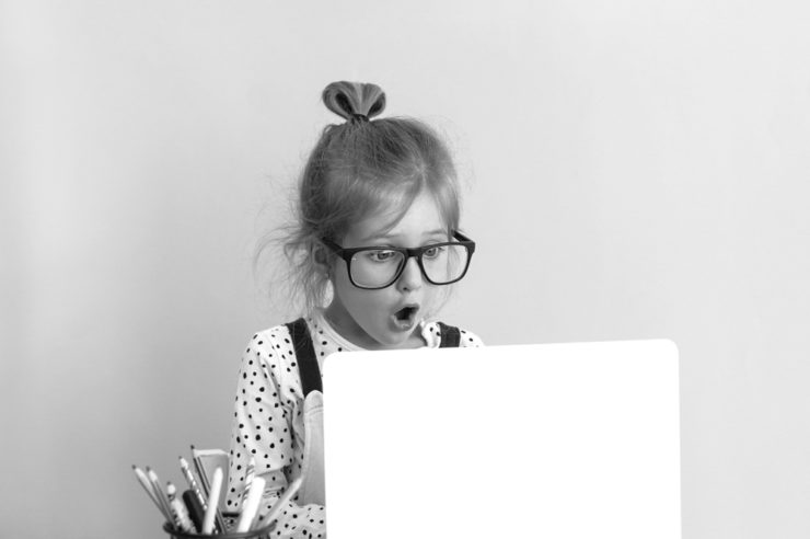 article cover image of a girl looking at a laptop