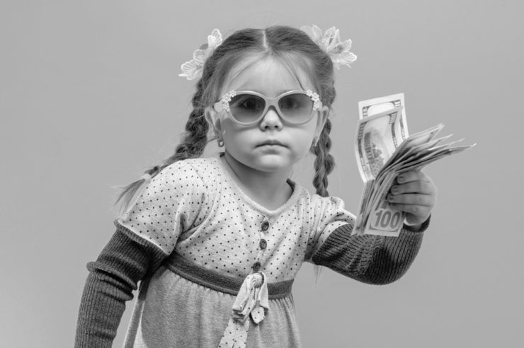 blog cover image of a child holding money